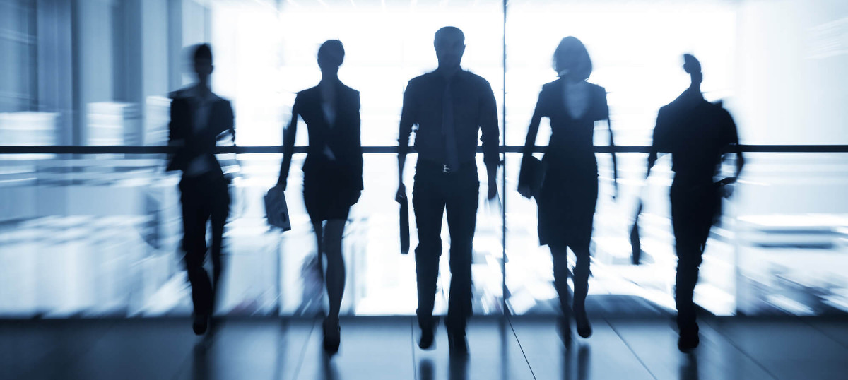 Stylized silhouette of business team walking towards the camera